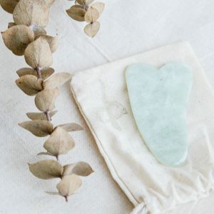 uniquely carved gua sha stone made from jade - buy online from our melbourne clinic